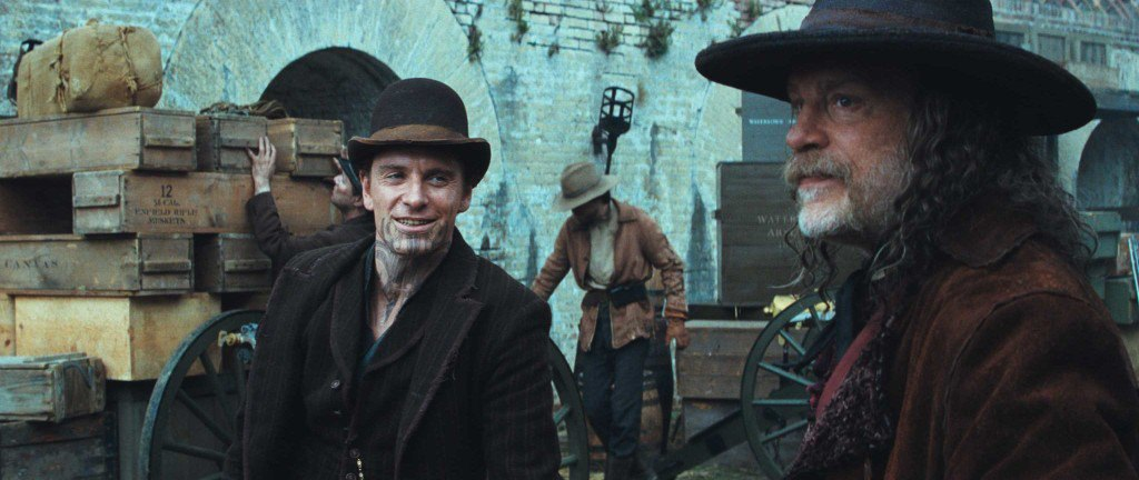 MICHAEL FASSBENDER as Burke and JOHN MALKOVICH as Quentin Turnbull in Warner Bros. PicturesÕ and Legendary PicturesÕ action adventure ÒJONAH HEX,Ó a Warner Bros. Pictures release. TM & © DC Comics.